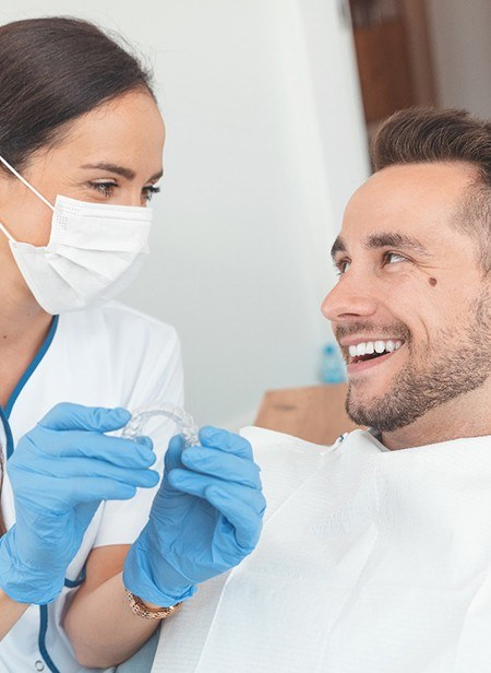 Dentist talking to patient about Invisalign