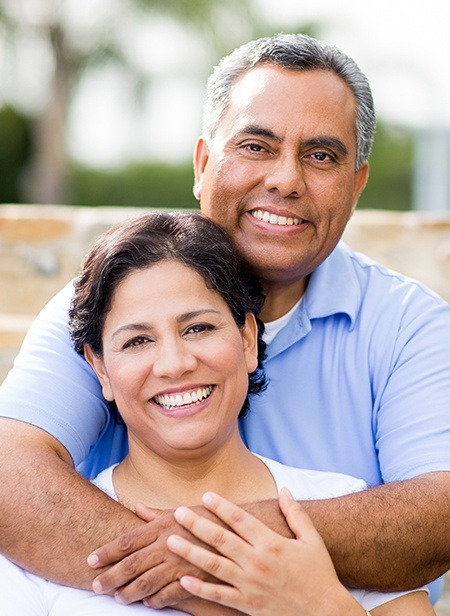 Man and woman with dentures smiling